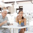 Couple having drinks at an outdoor cafe — Stock Photo