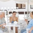Elderly parents lunching with their daughter — Stock Photo