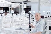 Elderly handicapped man at a restaurant — Stock Photo