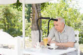 Handicapped man enjoying summer refreshments — Stock Photo