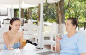 Mother and daughter having drinks — Stock Photo