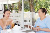 Mother and daughter having lunch together — Stock Photo