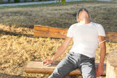 Man experiencing euphoria sitting on a bench — Stock Photo