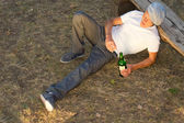 High angle view of an alcoholic man lying down — Stock Photo