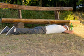 Adult drunk man sleeping down on the ground — Stock Photo