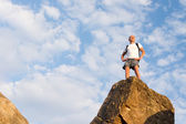 Successful male hiker standing on the mountain top — Stock Photo
