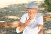 Caucasian man lighting a cigarette while relaxing — Stock Photo