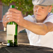 Drunk depressed man holding a bottle of wine — Stock Photo