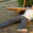 Drunk man fallen asleep on the ground — Stock Photo