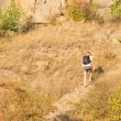 Stock Photo: Solitary man hiking on a mountain path