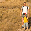 Father hiking with his small son — Stock Photo #30991641
