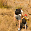 Father and son hiking on a mountain — Foto de Stock