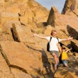 Jubilant father and son on a mountainside — Stock Photo