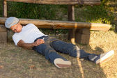 Addicted man passed out on the ground — Stock Photo