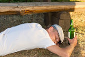 Alcoholic man passed out unconsciously — Stock Photo