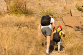 Father and son hiking on a mountain — Stock Photo