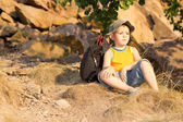 Little boy resting with his rucksack — Stock Photo