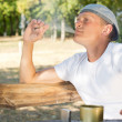 Man puffing on a cannabis or marijuana cigarette — Foto Stock