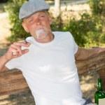 Постер, плакат: Addict smoking a joint of marijuana