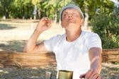 Caucasian man enjoying a rolled cigarette — Stock Photo