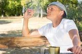 Man puffing on a cannabis or marijuana cigarette — Stock Photo