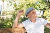 Thoughtful middle-aged man relaxing and smoking — Stock Photo