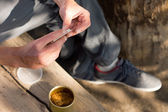 Man rolling a cannabis joint — ストック写真