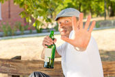 Alcoholic addict making a gesture of rejection — Stock Photo