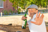 Alcoholic protecting his privacy — Stock Photo