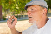 Man smoking a home rolled cigarette — Stock Photo