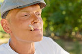 Thoughtful man smoking recalling good memories — Stock Photo