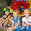 Three young children at a birthday party — Stock Photo #31154705