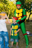 Young boy and his mother playing super heroes — Stock Photo