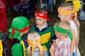 Small children in fancy dress at a birthday party — Stock Photo