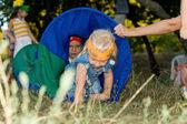 Children crawling through a fabric tube — Stock Photo