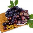 Platter of fresh ripe plums — Stock Photo