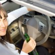 Stock Photo: Drunk female driver sitting behind wheel