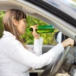 Female motorist drinking and driving — Stock Photo
