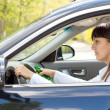 Stock Photo: Drunk female driver with impaired ability