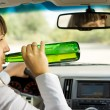 Постер, плакат: Intoxicated woman drinking and driving