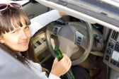 Drunk female driver sitting behind the wheel — Stock Photo