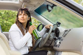 Woman drinking behind the wheel of her car — Stock Photo