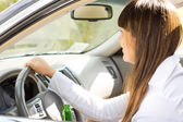 Drunk female motorist grinning as she drives — Stock Photo
