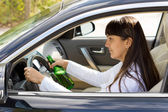 Drunk woman driver smiling as she drives — Stock Photo