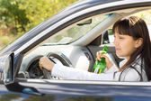 Happy inebriated female driver — Stock Photo