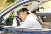 Drunk alcoholic female driver — Stock Photo