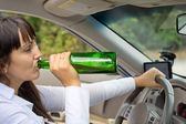 Drunk female driver in her car — Stock Photo