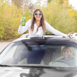Laughing drunk female car passenger — Stock Photo
