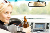 Smiling female driver drinking and talking — Stock Photo