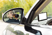 Female driver drinking as she drives — Stock Photo